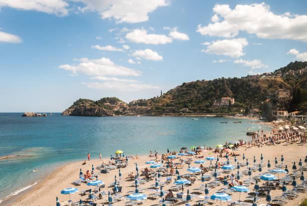 Beach near Taormina (Sicily) during the summer stock photo