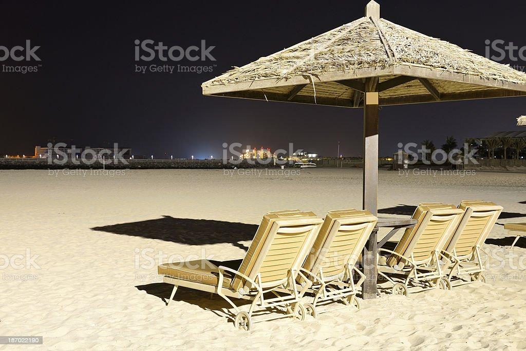 Beach night illumination with a view on Palm Jumeirah stock photo