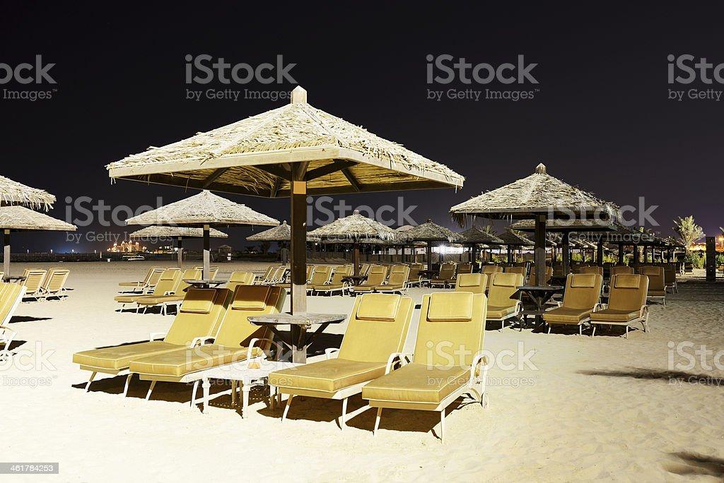 Beach night illumination with view on Palm Jumeirah, Dubai, UAE stock photo