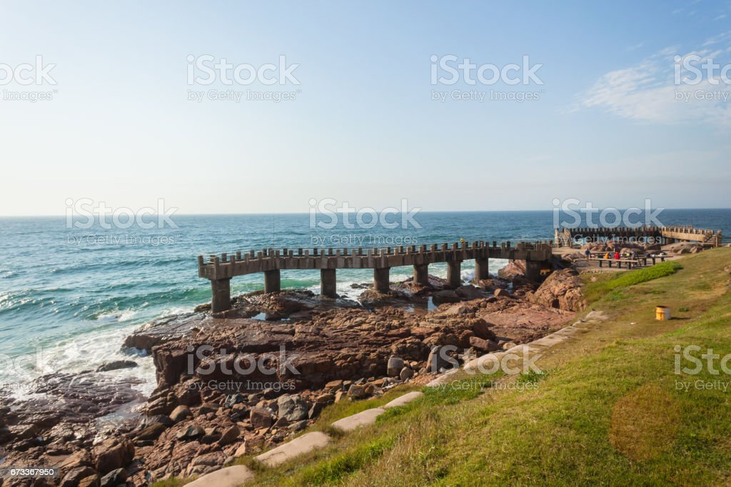 Beach Ocean Pier Rocky Coastline stock photo