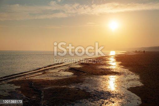 Beach of Baltic Sea in winter at sunrise