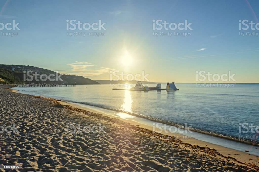 Beach of Black Sea from Albena, Bulgaria with golden sands, blue clear  water, yellow sun rays stock photo