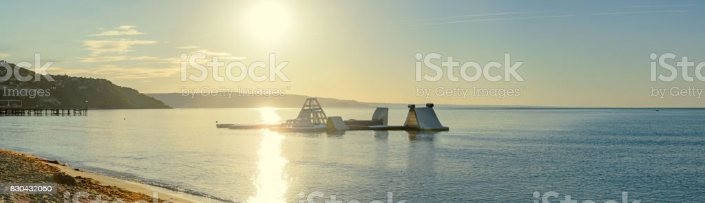 Beach of Black Sea from Albena, Bulgaria with golden sands, blue clear water, watersports at sunrise stock photo