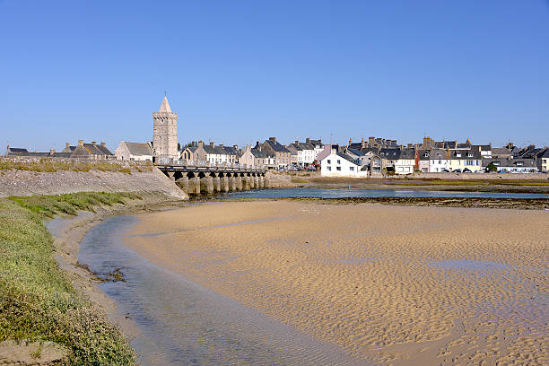 Beach of Port-Bail in France Beach and town with its church of Notre-Dame of Port-Bail or Porbail, a commune in the peninsula of Cotentin in the Manche department in Lower Normandy in north-western France cherbourg stock pictures, royalty-free photos & images