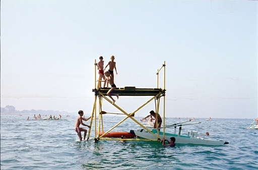 Rimini, Emilia-Romagna, Italy, 1967. Bathing island / bathing pond with kids swimming in the Adriatic Sea. The Panton is located in front of the beach of Rimini, one of the popular seaside resorts on the Adriatic coast in the sixties.