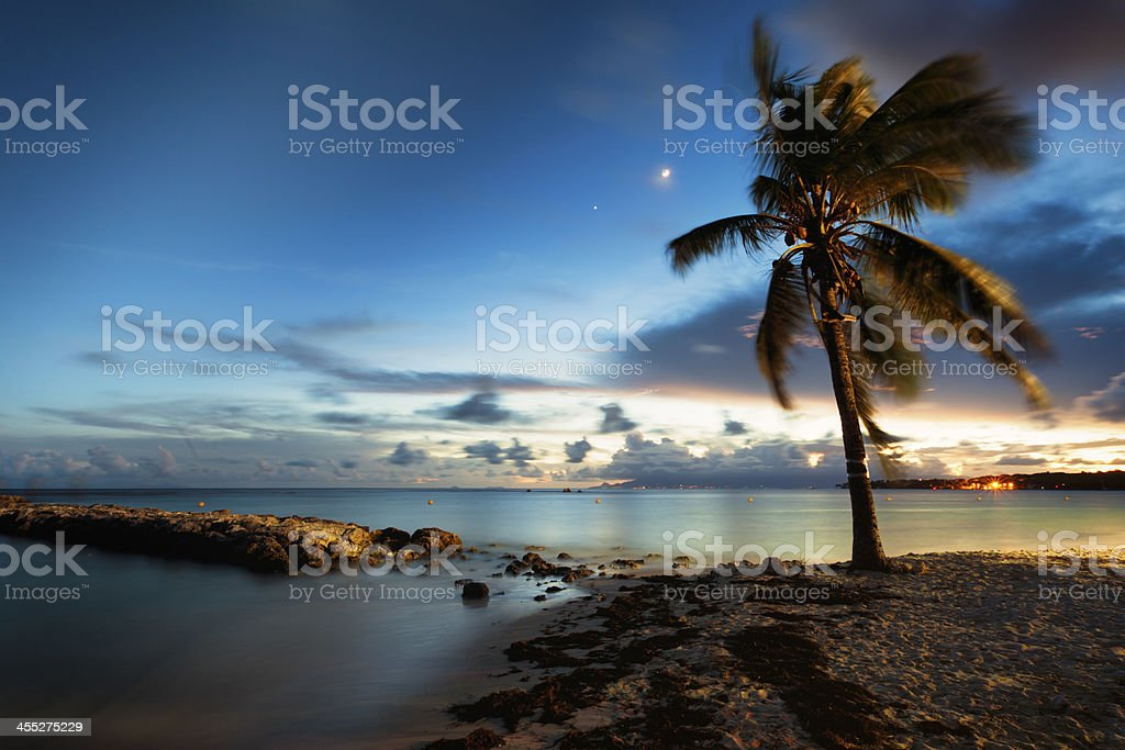 Beach of Saint-Anne, Guadeloupe, after sunset stock photo
