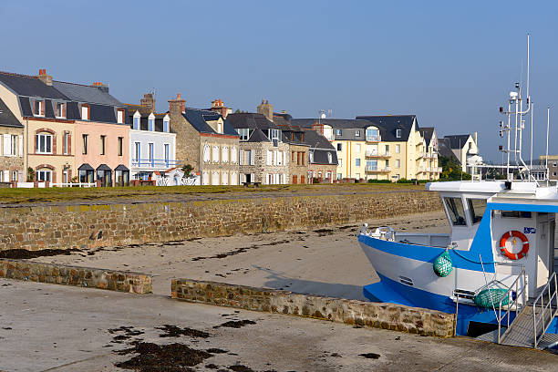 Beach of Saint-Vaast-la-Hougue in France Beach and boat at Saint-Vaast-la-Hougue, a commune in the peninsula of Cotentin in the Manche department in Lower Normandy in north-western France cherbourg stock pictures, royalty-free photos & images