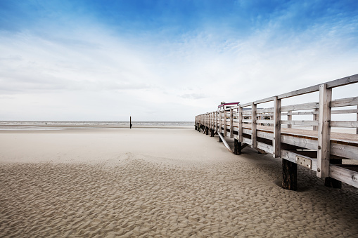 Beach of St. Peter-Ording in Germany with pile dwelling