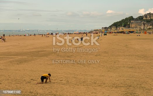 Trouville, France - August 20, 2018: Beach of Trouville-sur- Mer. People are resting on the coast of the English Channel in Trouville. The region is Basse-Normandie in the Calvados department. France