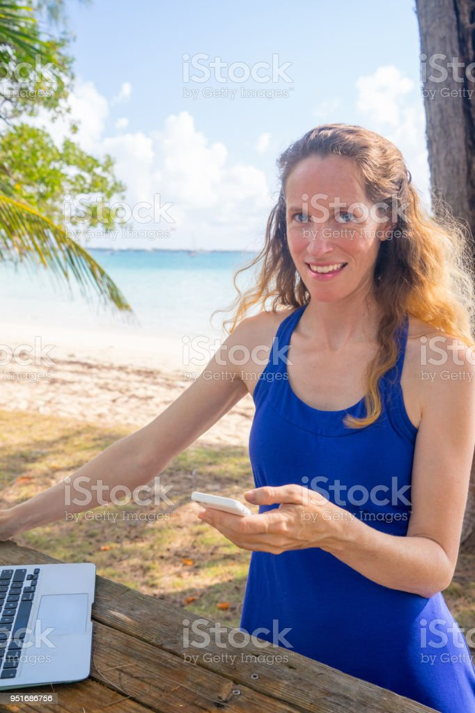 Beach Office Work Online From Anywhere stock photo