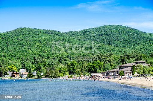 Beach on Lake George with people in far background