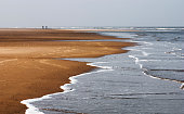 Endless beach on German Northsea island Langeoog in Wadden sea national parc in Lower Saxony.