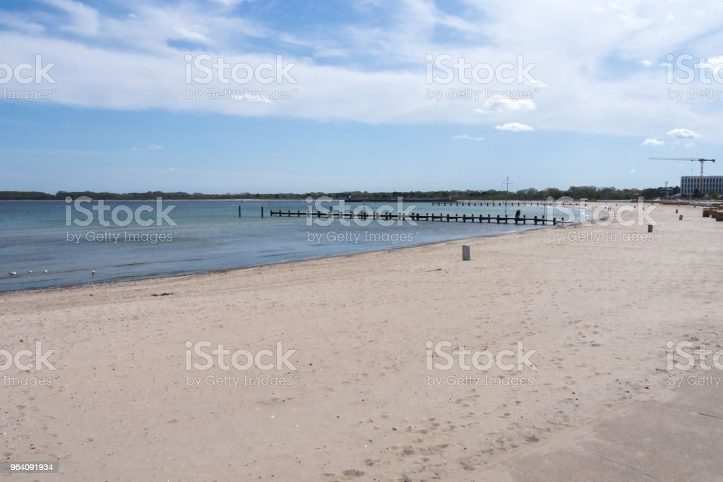beach on the baltic sea with a view of two wooden bridges - Royalty-free Accidents and Disasters Stock Photo