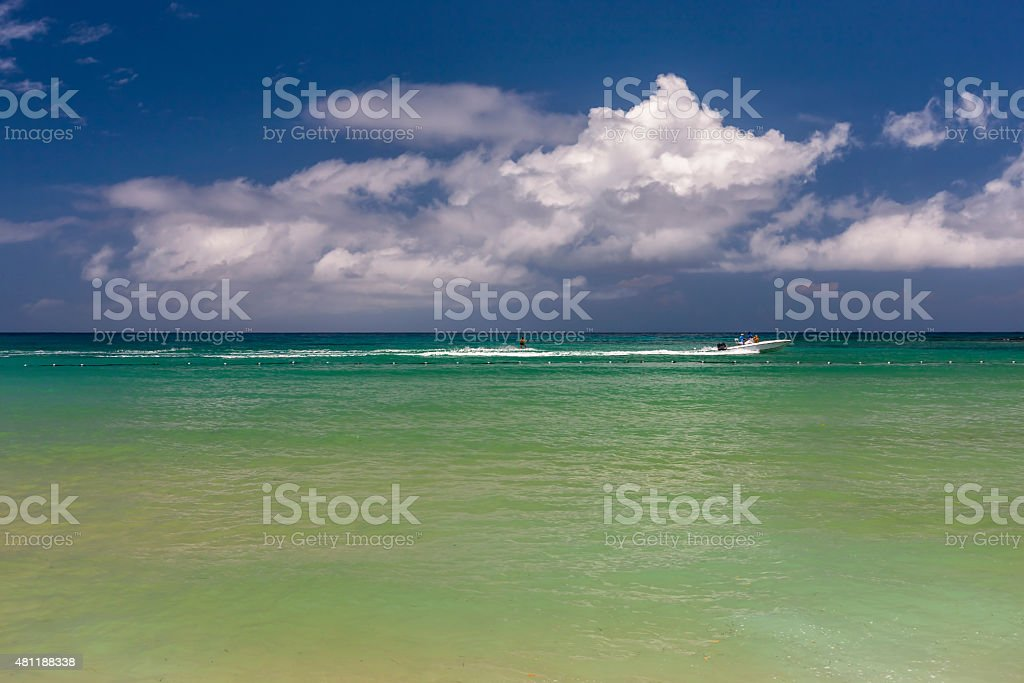 Beach on tropical island. Clear blue water and sky stock photo