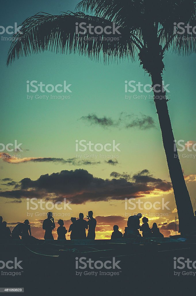 Beach party at sunset stock photo