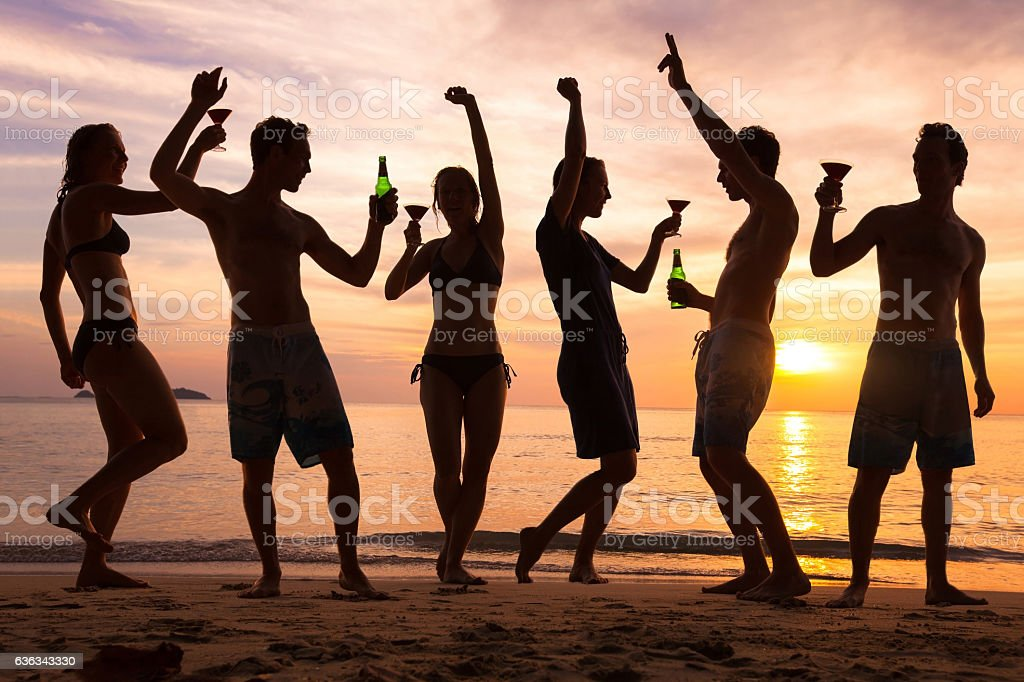 beach party, group of young people dancing, friends stock photo