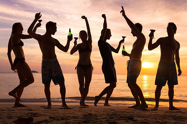 beach party, group of young people dancing, friends ストックフォト