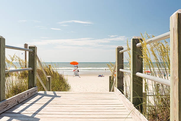 Beach Typical summer day in Myrtle Beach. boardwalk stock pictures, royalty-free photos & images