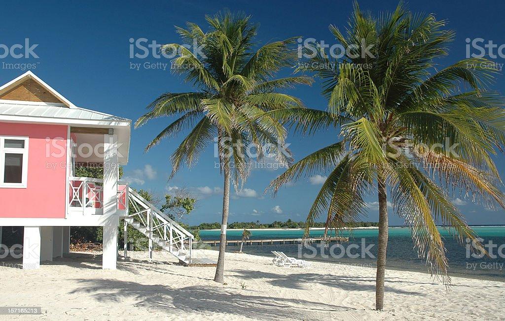 Beach - Pink Villa on the sand stock photo