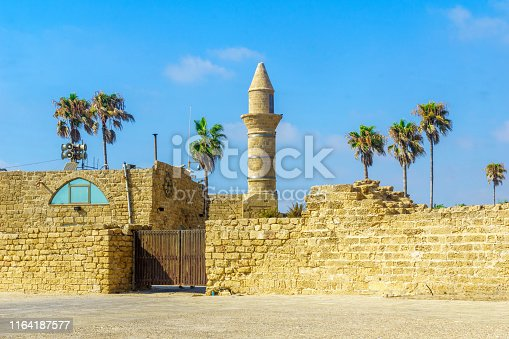 View of the beach promenade and the old port in Caesarea National Park, Northern Israel