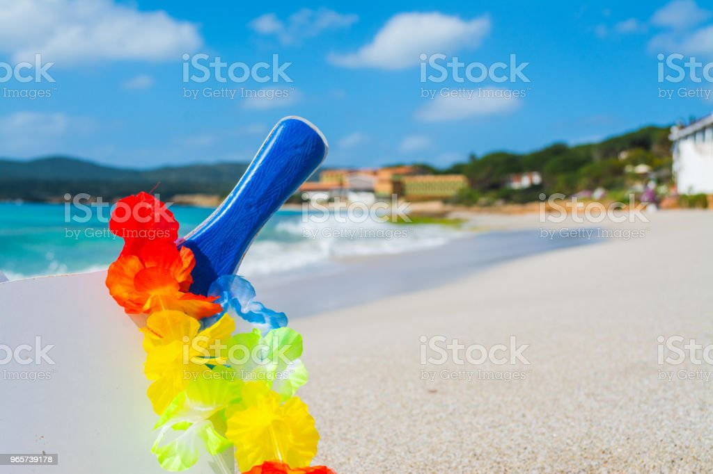 Beach racket and necklace on the sand - Royalty-free Beach Stock Photo