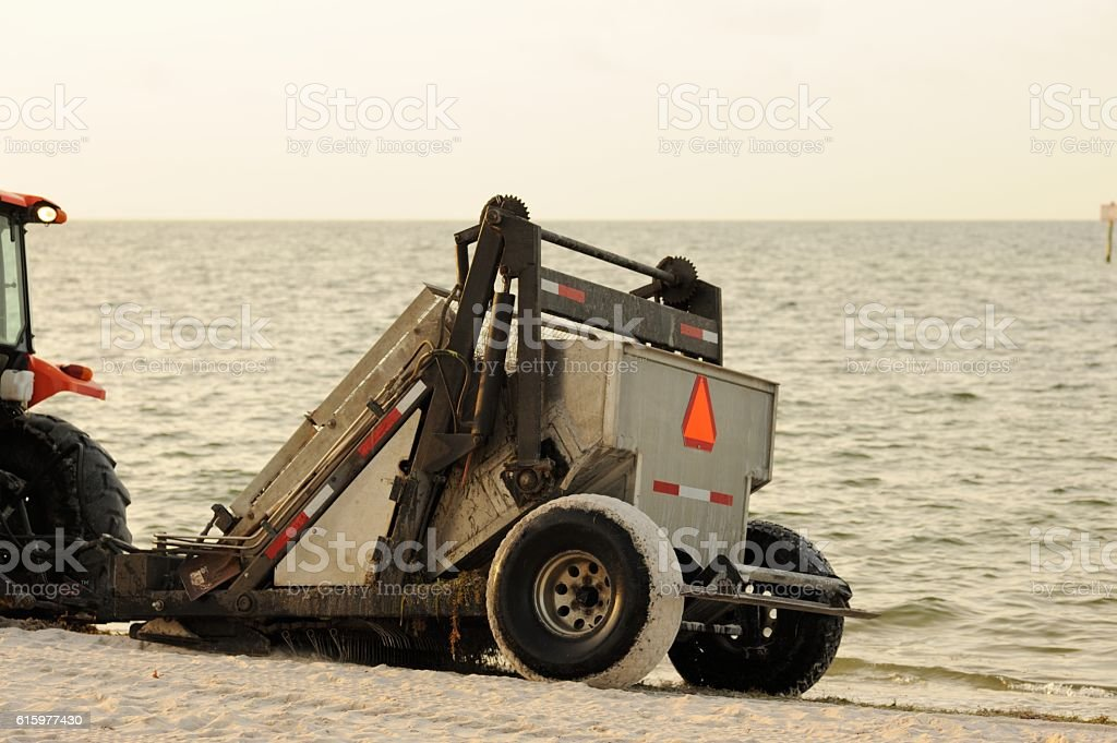 Beach rake equipment being towed by tractor stock photo