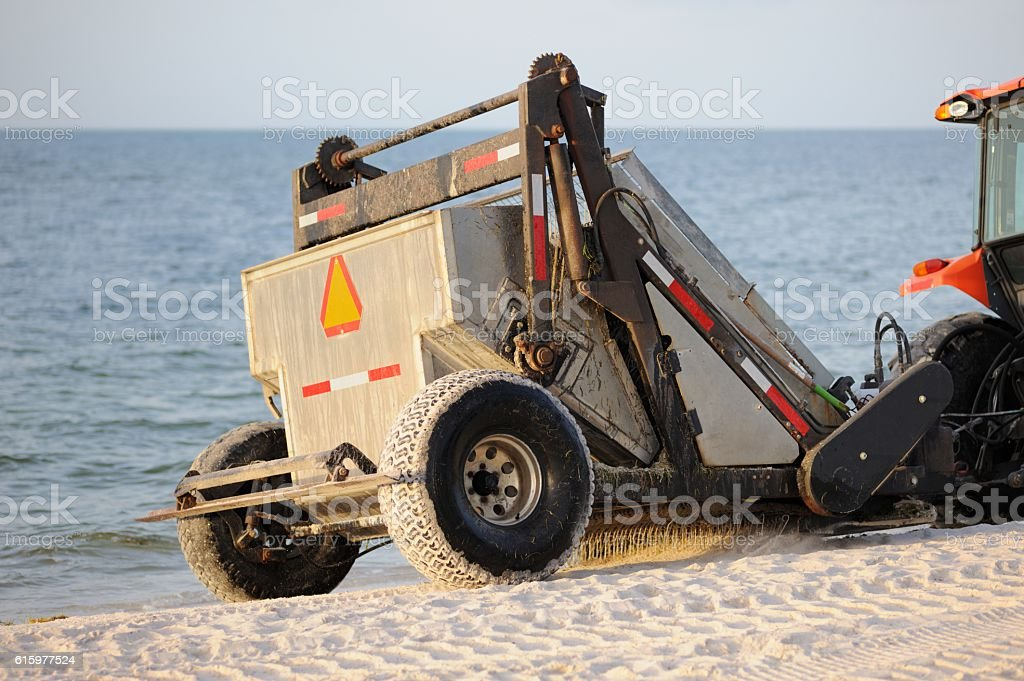 Beach raker being pulled by tractor stock photo