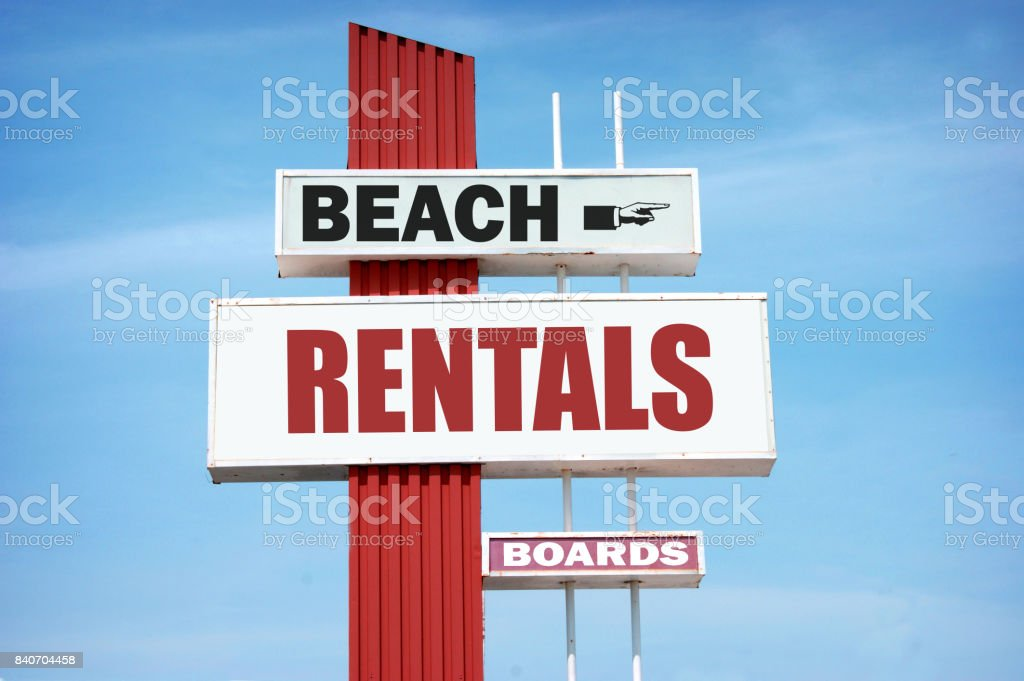 beach rentals sign stock photo