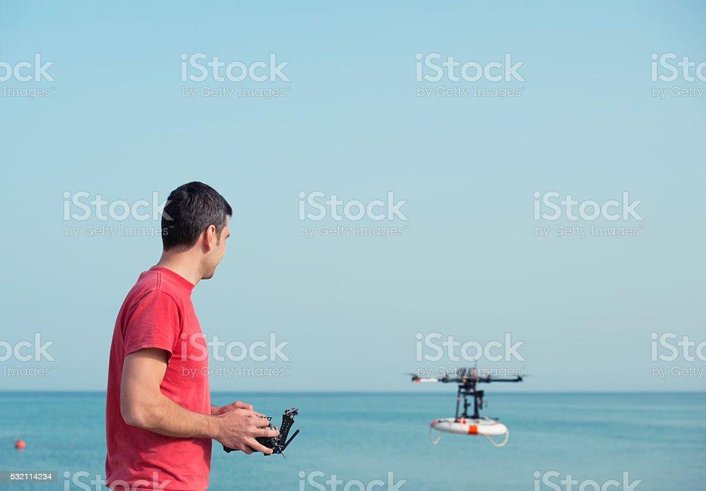 Beach rescue UAV Pilot. stock photo