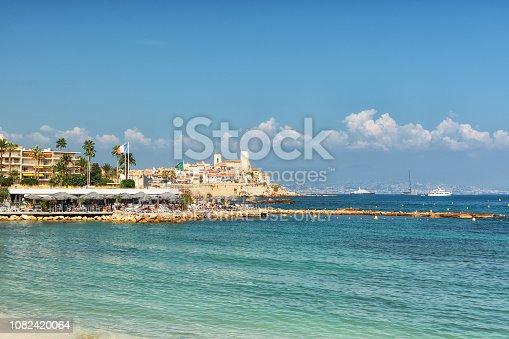 istock Beach restaurant in front of the old city wall of the French town of Antibes 1082420064
