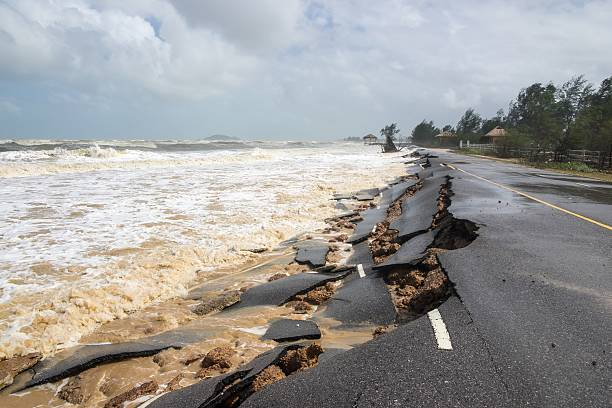 Beach Road slide by water and wind Beach Road slide by water and wind eroded stock pictures, royalty-free photos & images