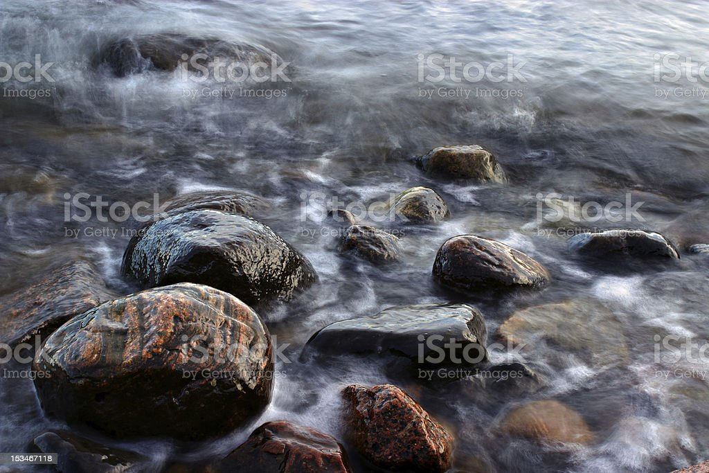 Beach rocks in windy evening royalty-free stock photo