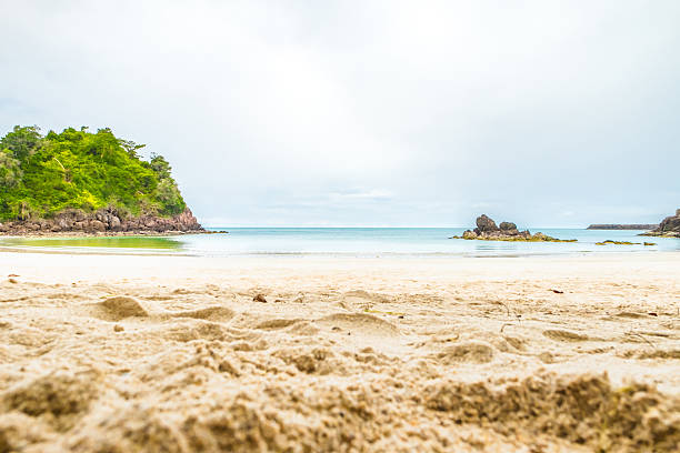 Beach sand and sea with rock,Landscape view of sea stock photo