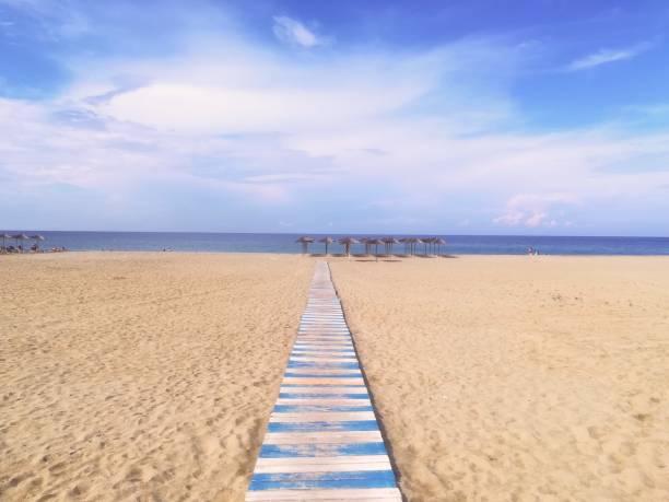 Beach, sand, Sun and sky stock photo