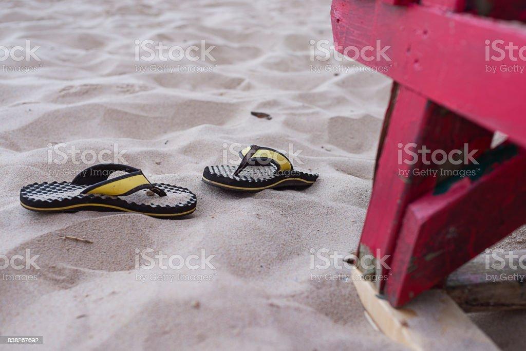 Beach sandals forgotten on the beach stock photo