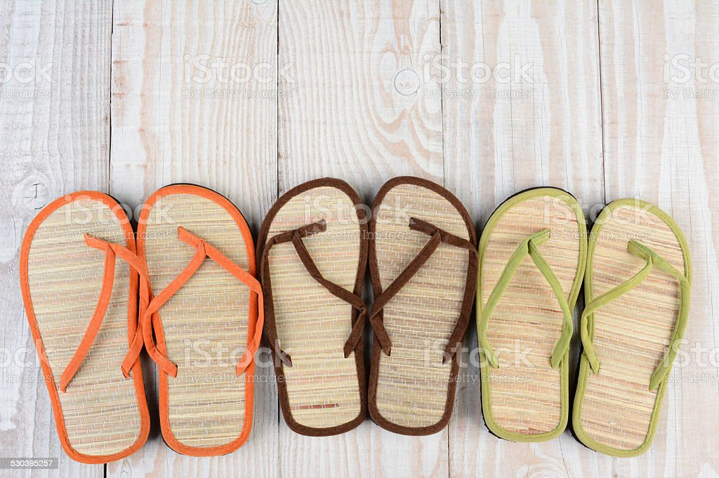 Beach Sandals on Wood Deck stock photo