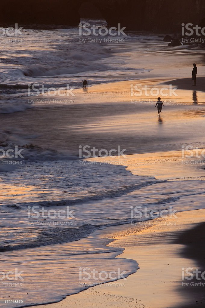 Beach Scene at Sunset stock photo