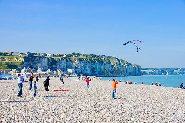 Beach scene, Dieppe Dieppe, France - September 16, 2012: Beach scene, with kites, fishermen, locals and visitors, in Dieppe, France dieppe france stock pictures, royalty-free photos & images