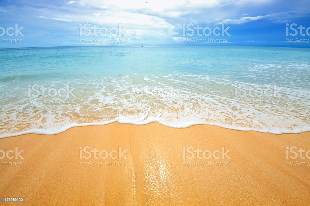 Beach scene showing sand, sea and sky royalty-free stock photo