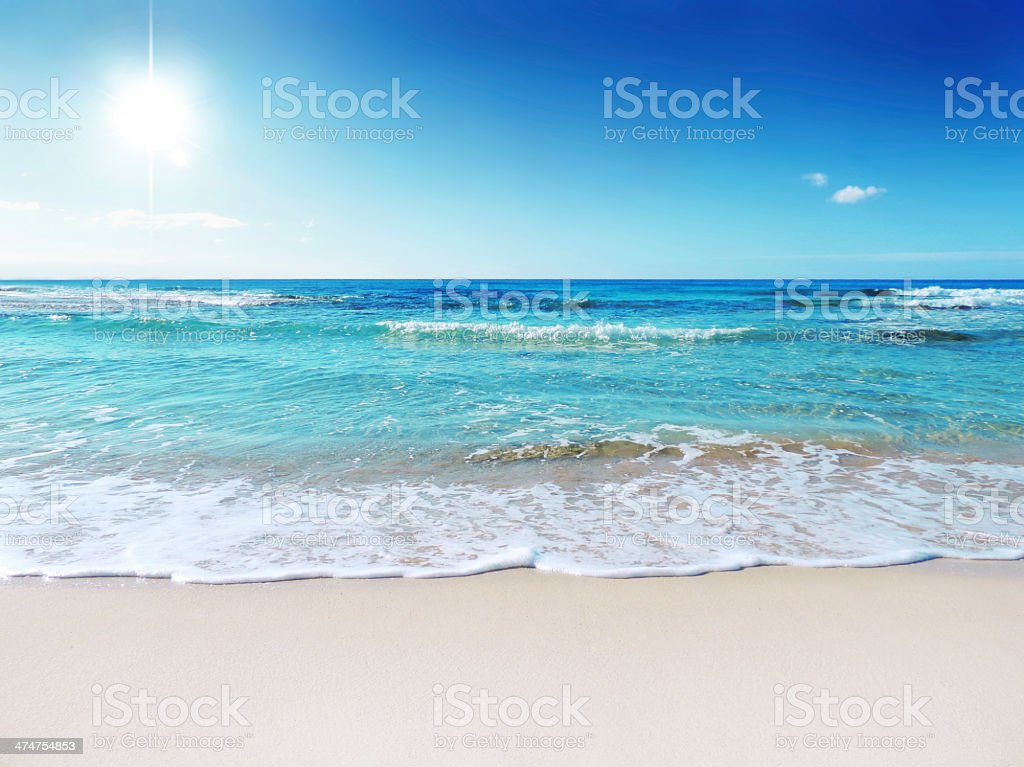 Beach scene showing sand, sea and sky stock photo