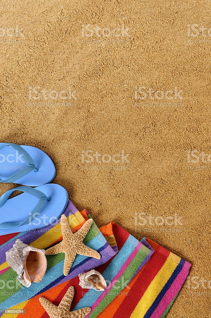 Beach backgound with towel, flip flops and starfish . Copyspace...