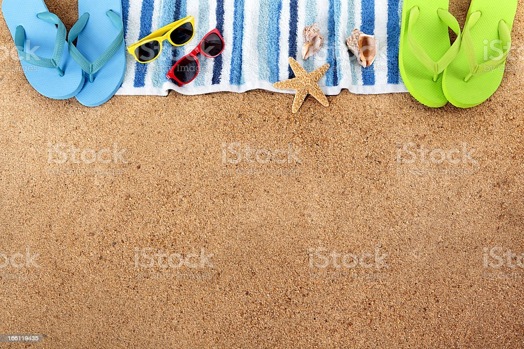 Beach background border with sunglasses, towel, starfish and...