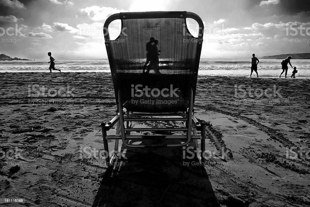 beach scene with deck chair on sunny day royalty-free stock photo