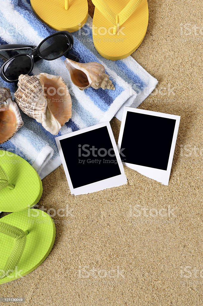 Beach background with towel, flip flops, notebook and blank photo...