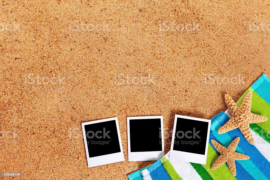 Beach scene with polaroid photos stock photo