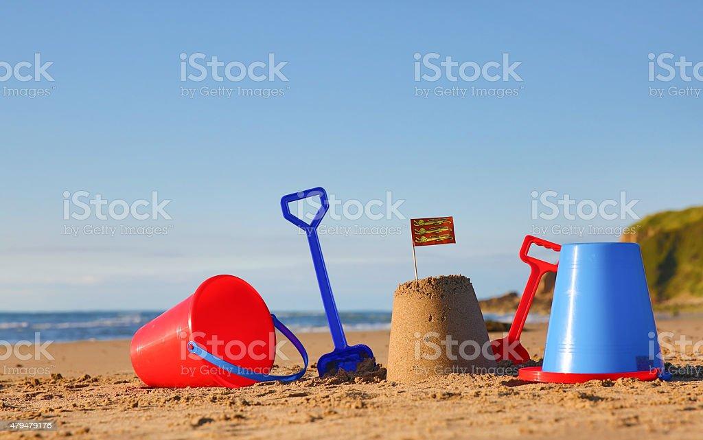 Beach, sea, buckets, spades and Welsh Flag stock photo