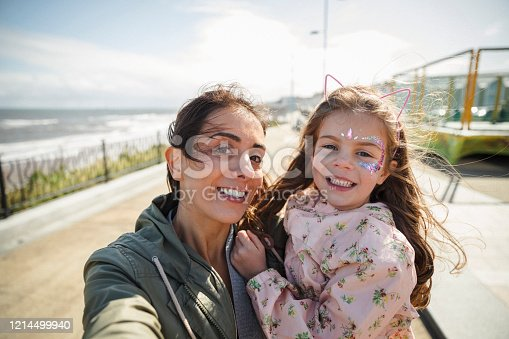 A selfie shot of a woman and her young daughter enjoying a day out in Whitley Bay. They are looking at the camera and smiling.