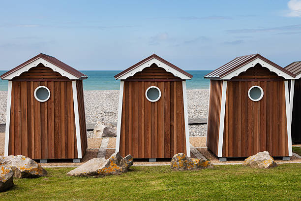 Beach shed in Normandy Beach shed in Normandy. Normandy, France dieppe france stock pictures, royalty-free photos & images