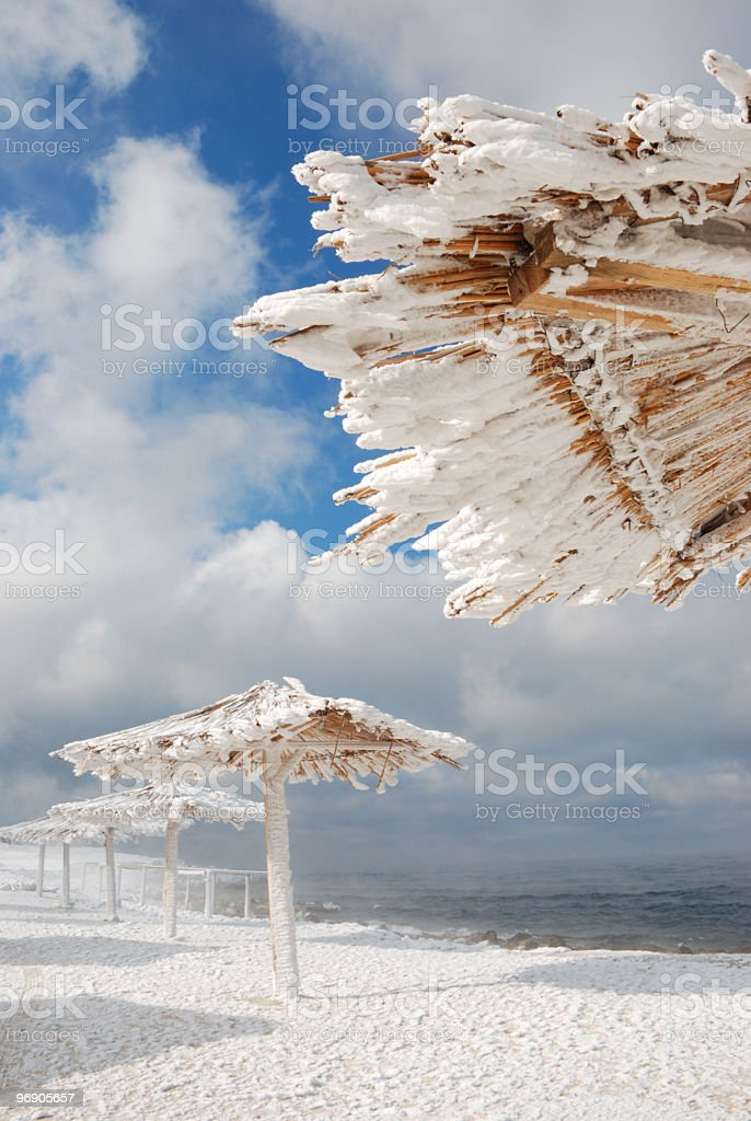 beach shelters under the snow royalty-free stock photo