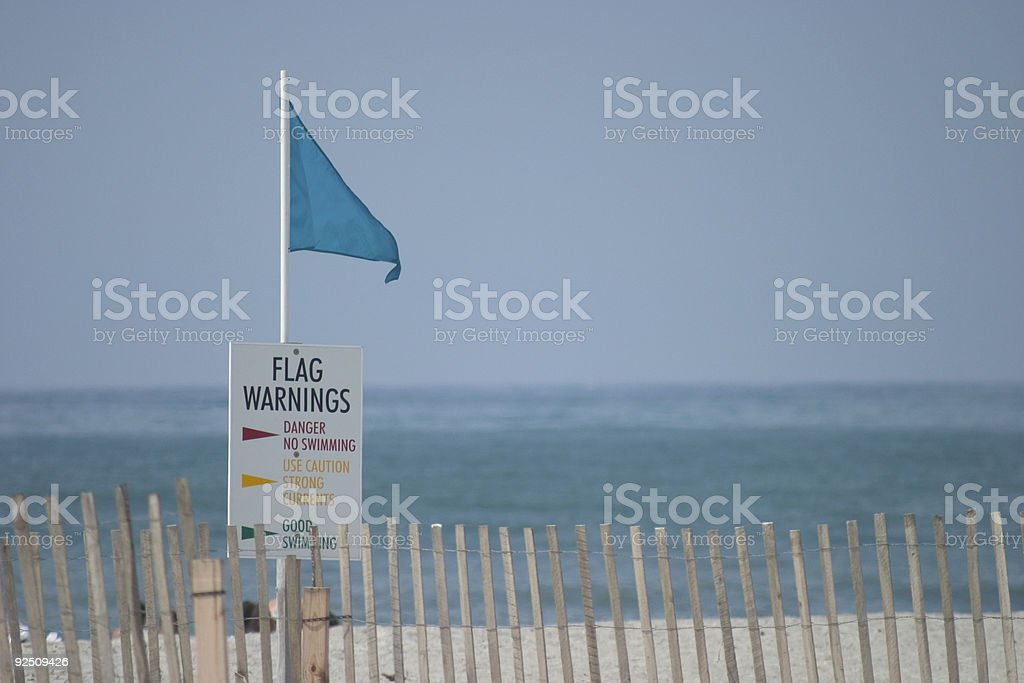 Beach sign and flag royalty-free stock photo